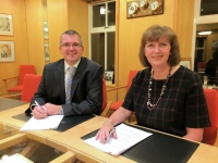 Transas area sales manager James Woodward and Lerwick Port Authority chief executive Sandra Laurenson sign the agreement