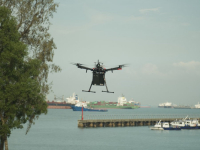The drone carrying the 3D-printed part to a vessel at a nearby anchorage. Image courtesy of MPA