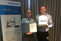 Matt George of Network Innovations (left) and Henrik Fyhn of Cobham SATCOM mark the 50,000th unit delivery