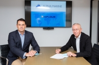 Manolis Lazaridis (left) of the Diaplous Group and Antonis Iordanidis (right) of Alpha Marine Consulting sign the partnership agreement.