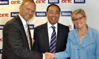 Serge Van Herck, Newtec; CETC54's president Tu Tianjie; and the Belgian government's State Secretary for Science Policy, Elke Sleurs
